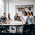 group-of-people-working-out-business-plan-in-an-office_1303-15773